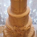 tall lace and flowers wedding cake