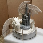 elaborate dragon with castle cake
