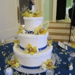 beautifully decorated wedding cake with yellow flowers
